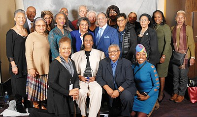 (First row, center): Honoree Vaile Leonard, Founder/CEO of Light of Truth Center is surrounded by supporters.
