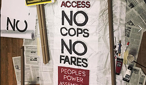 Protest signs for subway demosntration