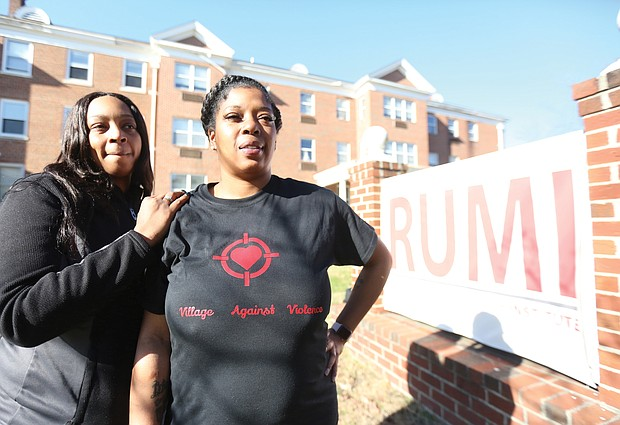 Kele A. Wright, left, and Shavon M. Ragsdale are seeking to turn grief into positives for the community through their organization, The Village Against Violence. They stand in front of the Richmond Urban Ministry Institute, 3000 Chamberlayne Ave., where the group is based.