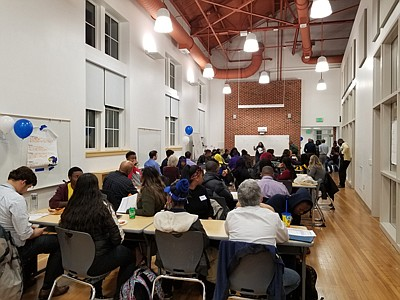 Mentors and students share ideas about getting started at the iMentor orientation November 13, 2019 at the Academy for College and Career Exploration.