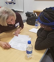 Students and their mentors review their commitment to each other at the iMentor orientation at the Academy for College and Career Exploration.