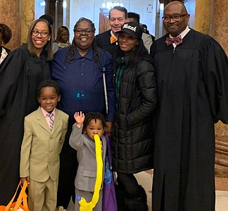 Judge Kendra Ausby, Mitchell Lanier, age 5, Elladonna Lanier, Messiah Lanier, age 2, Judge W. Michel Pierson, Chiquita Polk, social worker and Judge Emanuel Brown take a moment to celebrate after the National Adoption Day Ceremony at The Clarence Mitchell, Jr. Courthouse November 23, 2019
