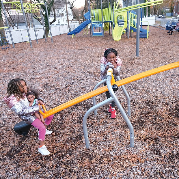 Life can be a balancing act, even when you're young and on a see-saw. On Sunday, Ava El, 6, left, plays on a see-saw with friend Tye'asjah Morris, 6, right, at the Third Avenue Tot Lot in Highland Park as her sister, Kailee El, 8, waits her turn. The youngsters were at the lot at Third Avenue and Althea Street under the watchful eye of mother Ashley El, who can be seen on the bench in the background.
