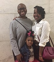 L-r:  Dawnyell Harris stands proudly with her daugters 4-year-old Sage and 14-year-old Kristyana. Sage officialy became a member of the family during the National Adoption Day ceremony at The Clarence Mitchell, Jr. Courthouse  November 23, 2019