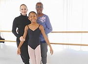 Aanaiyah Jones (center) is learning the skills necessary to become a professional ballerina thanks to the mentorship and instruction she receives from Sarah Rigles (left), director of the Classical Ballet, and the support and the encouragement of her grandmother, Bettye Jones.