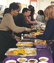 The Walnut Park Shelter on Northeast Martin Luther King Jr. Boulevard had a full Thanksgiving Day meal thanks to the hard work of volunteers who stepped up at the last minute to feed scores of homeless residents.