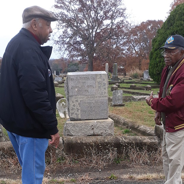 Charles S. Vaughan, left, and Eddie Radden Jr. view improvements at the historically black Mount Olivet Cemetery in South Side for which they have lobbied City Hall for several years.