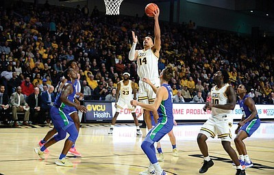 VCU's rich basketball history features a lengthy list of impressive big men. Marcus Santos-Silva is the latest shining example.