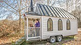 Donald McWilliams Jr. and Roberta Jennings recreate their engagement pose on the landing of the 100-square-foot tiny chapel where they will become husband and wife before the Richmond Christmas Parade on Saturday, Dec. 7.