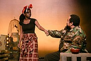 Julet Lindo plays Sophie and Bobby Bermea plays Osembenga in 'Ruined' the Pulitzer prize winning play by African American playwright Lynn Nottage, now playing through Sunday, Dec. 8 at Profile Theatre, 17 S.E. Eighth Ave.