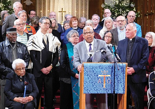 Rev. LeRoy Haynes of northeast Portland's Allen Temple CME Church shares his thoughts among a group of religious leaders from all over Portland who gathered on Monday to announce and show support for a new effort at reducing gun violence in Oregon, a new voters initiative petition to ban the sale of semi-automatic guns and large capacity ammunition magazines. Kicked off at Augustana Lutheran Church, also in northeast Portland, the new Lift Every Voice campaign will gather signatures in hopes of making the ballot for next year's November presidential election.