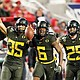 Troy Dye (from left) Deommodore Lenoir and Brady Breeze celebrate after Dye intercepted a Utah pass in route to a Pac-12 Conference championship in Santa Clara, Calif., Friday. Oregon won 37-15. (AP photo)