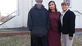 Jerome Legions, president of the Carver Area Civic Improvement League, stands with 2nd District City Councilwoman Kim B. Gray, center, and past civic league president Charleen Baylor outside the vacant Moore Street School in the Carver neighborhood.