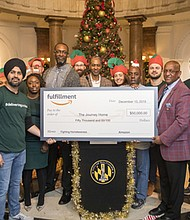 "Amazon leaders and associates from the greater Baltimore area make a special delivery of 2,000 ""Boxes of Smiles,"" filled with essential items and popular products, along with a surprise $50,0000 donation to The Journey Home for local individuals and families experiencing homelessness."