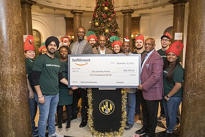 """Amazon leaders and associates from the greater Baltimore area make a special delivery of 2,000 """"Boxes of Smiles,"""" filled with essential items and popular products, along with a surprise $50,0000 donation to The Journey Home for local individuals and families experiencing homelessness."""