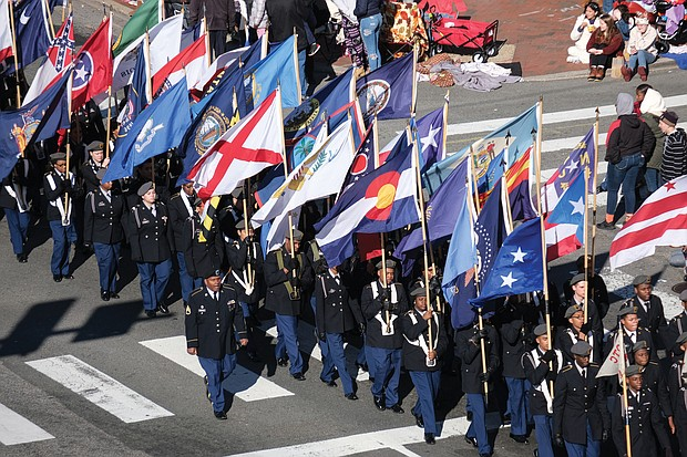 Students from Richmond's Franklin Military Academy parade with a colorful array of flags