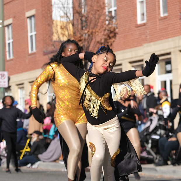 Members of the Dangerous Royalettes Dance Team strut their stuff in the 36th Annual Christmas Parade last Saturday. Thousands of spectators lined the 2-mile route along Broad Street between the Science Museum of Virginia and 7th Street in Downtown to watch an array of floats, marching bands, character balloons bring the holiday spirit.