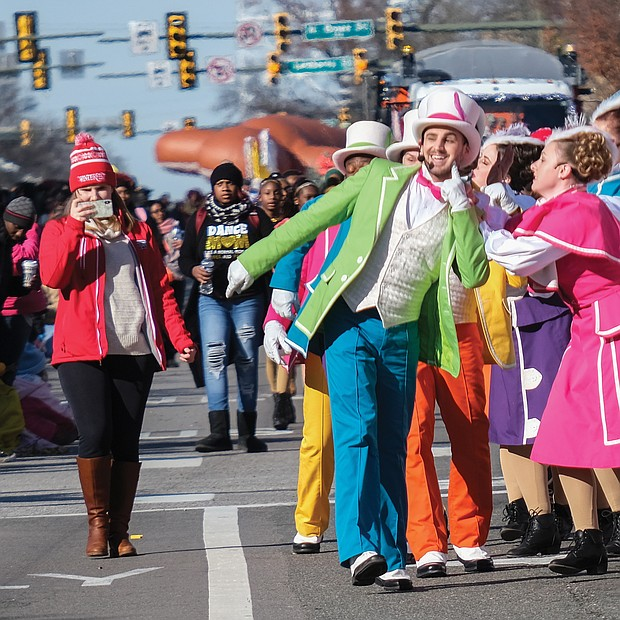 Performers from Kings Dominion entertain spectators as they march along the route.