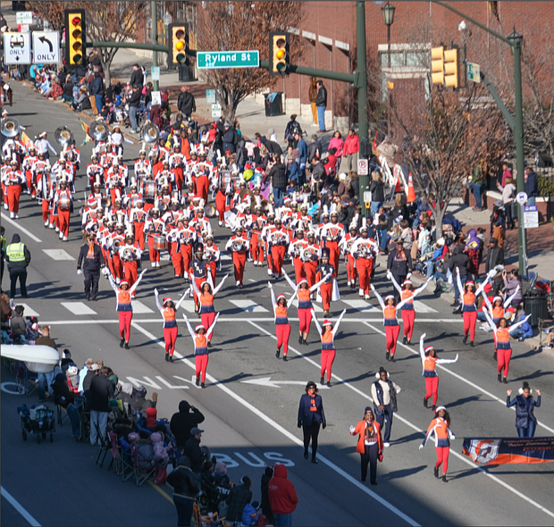 The Virginia State University Trojan Explosion Marching Band puts out a big sound as they march down the route into Downtown.