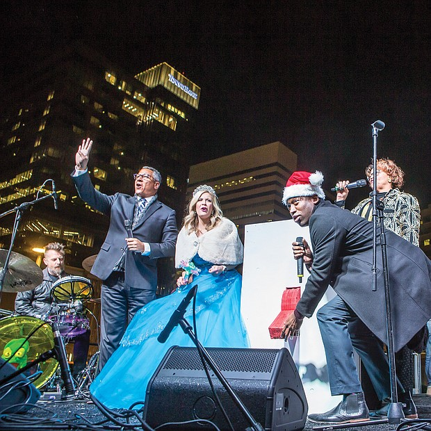 Mayor Levar M. Stoney is poised during the countdown to flip the giant switch to light up the city's skyline.