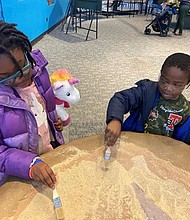 (Left) Samia and Uriyah Ma'at; and Ji'Air Ford (right) attended the Annual Casey Cares Holiday Party at the Maryland Science Center on Saturday, December 14, 2019.