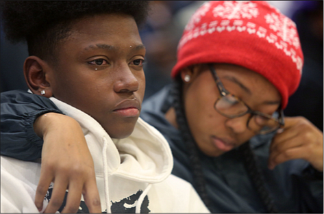 Devin Carter, 15, left, and his cousin, Davionna Green, remember and honor Devin's brother, Drequan X. Trice, 18, who was killed in August in North Side.