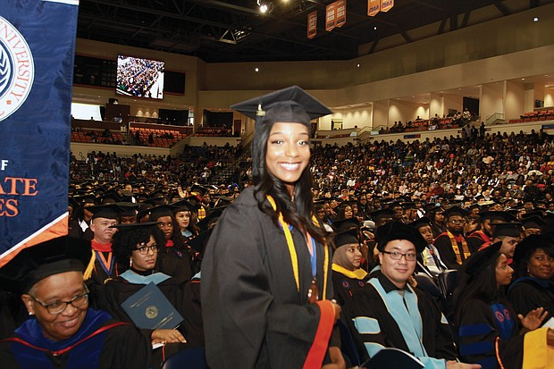 Jessica Brisco stands to be recognized as the top fall graduate at Virginia State University dur- ing fall commencement exercises last Saturday at the university's Multi-Purpose Center. Ms. Brisco, who earned a 4.0 GPA, received a bachelor's in information logistics technology. She was among 304 students who received their degrees during the ceremony.