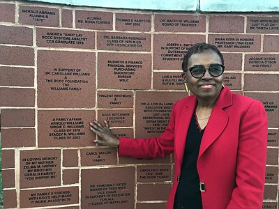 """""""A Family Affair."""" Williams touches a brick on the BCCC Brick Wall of Recognition, which includes her name, along with the names of her husband and daughter. The three are all graduates of the school"""