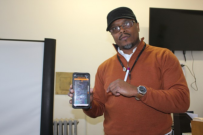 Richard Wooten, a longtime Chatham resident and retired Chicago police officer, has developed a new mobile app that's free and allows a user to quickly contact 911 and up to five contacts, all at once, during an emergency. Photo credit: By Wendell Hutson
