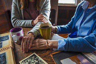 Keep building on old traditions where you can; share old family photos with the person living with Alzheimer's disease and reminisce