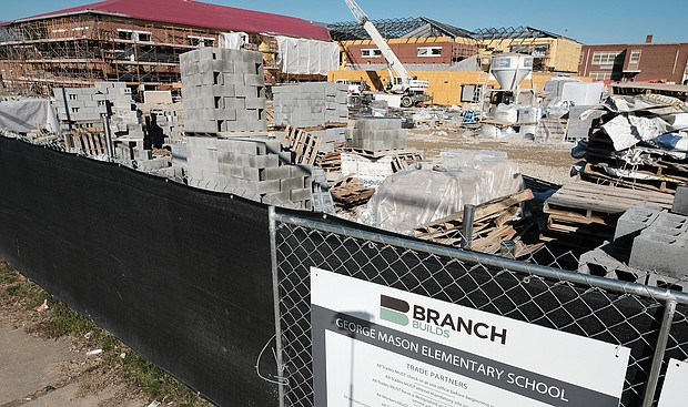 George Mason is one of three new schools under construction that are expected to be ready for the 2020-21 academic year. Building supplies are stacked and ready for use in the $38.4 million project. (Sandra Sellars/Richmond Free Press)