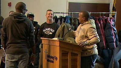 Head coach John Harbaugh and the Ravens teamed with the Helping Up Mission to distribute coats for their 2019 coat drive.