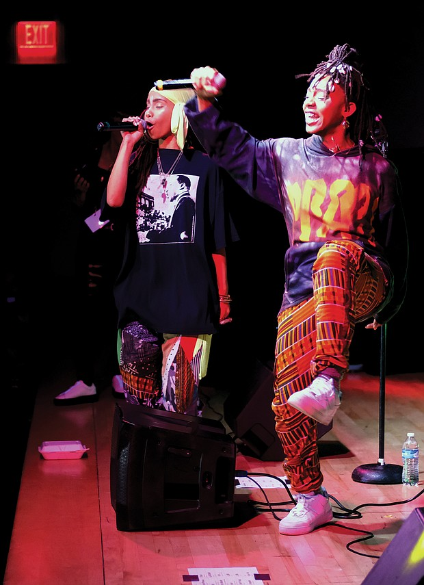 Niambi Sala, left, and Thandiwe of the hip-hop/soul duo OSHUN inspire the crowd with song. The annual celebra- tion of African-American culture ran Dec. 26 through Jan. 1, honoring seven principles — unity, self-determination, collective work and responsibility, cooperative economics, purpose, creativity and faith.