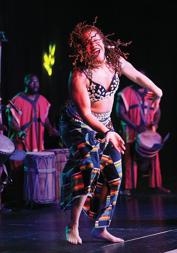 Imani Bell of the Elegba Folklore Society, which puts on the festival, performs with African drummers.