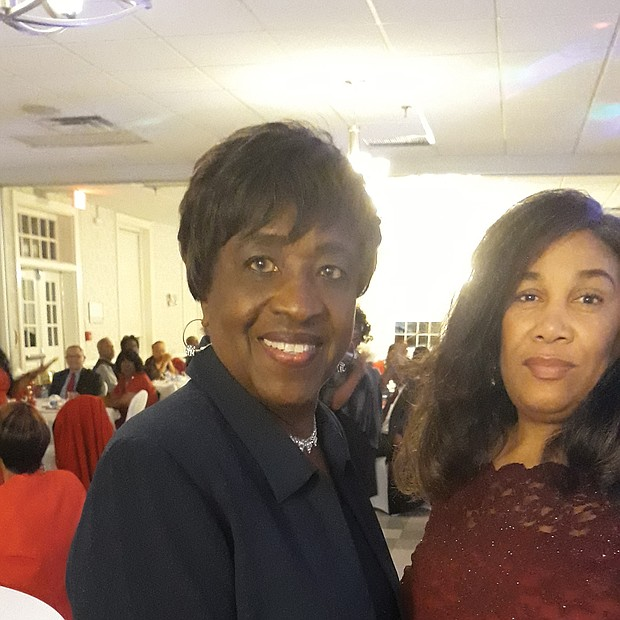 More than 100 people turned out for the 3rd Annual Holly Ball Gala sponsored by the Richmond Metropolitan Chapter of The Charmettes to raise money for cancer research. Chapter President Edna Rodwell, left, shares a moment with Melissa Dilworth, chair of the committee that staged the benefit dinner- dance on Dec. 27 at the Belmont Recreation Center in Henrico County.