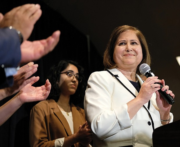 Ghazala F. Hashmi receives cheers and applause from supporters as she address the crowd at the Democrats' victory party following her upset win in November in the Richmond area's 10th Senate District. She is the first Muslim elected to the state Senate. Below, Stephanie A. Lynch celebrates her victory in November's special election in the Richmond City Council 5th District contest.