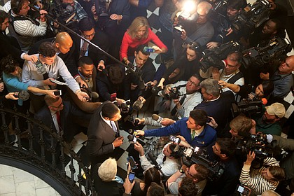 Just days later, Lt. Gov. Justin E. Fairfax, center, is swarmed by reporters inside the Capitol Rotunda as he responds to allegations that he sexually assaulted a woman in 2004 while he was a law school student. Following that allegation, Virginia Attorney General Mark R. Herring announces he dressed in blackface at a fraternity party in 1980 when he was a student at the University of Virginia. All three men remain in office.