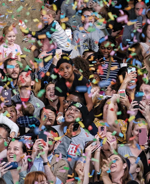 More than 2,000 people erupt into cheers at the coming of 2020 at the Science Museum of Virginia's Noon Year's Eve celebration. At the stroke of noon on Dec. 31, confetti dropped from the top of the rotunda as youngsters and their families celebrated New Year's early on Tuesday. The annual celebration is geared to the young and those who have a hard time staying up until midnight to welcome the new year.