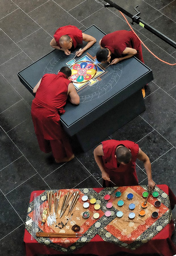 Tibetan Buddhist monks from the Drepung Loseling Monastery in India create a sand mandala in May at the Virginia Museum of Fine Arts to share Tibet's sacred visual and performing arts in conjunction with an exhibit at the museum.
