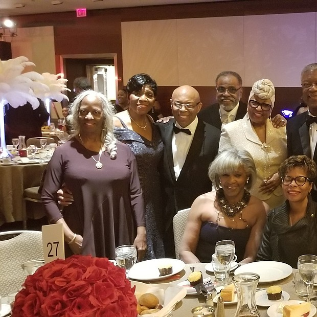 Gala Foundations Shirley and Edward Calahan enjoyed guests at the table of Carmen Lemons, CEO Lem's Barbecue.