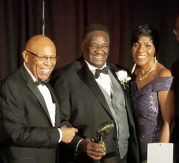 "Calahan Foundation hosted its ""11 Annual Celebration of Giving"", at the Hyatt Regency Chicago.      Among the evening honoree were Retired Senator Emil Jones .  Joining the Calahan's for a photo is the owner of Kates Security.  Photo by:  Tarji Smedley"