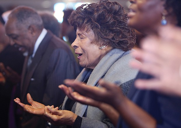 Nellie Crump Thomas prays at the New Year's Day program at Fifth Baptist Church in the West End. The audience included leaders of Richmond City Council and the School Board, incoming Richmond state Sen. Ghazala Hashmi and other area elected officials. The Baptist Min- isters' Conference of Richmond and Vicinity, led by the Dr. Emanuel C. Harris, hosts the event to remember the day when President Abraham Lincoln issued his Civil War proclamation on Jan. 1, 1863, freeing slaves in the South. The Rev. Ricardo Brown, co-pastor of Fifth Baptist Church, served as chair of the program that also raises money for area NAACP branches.