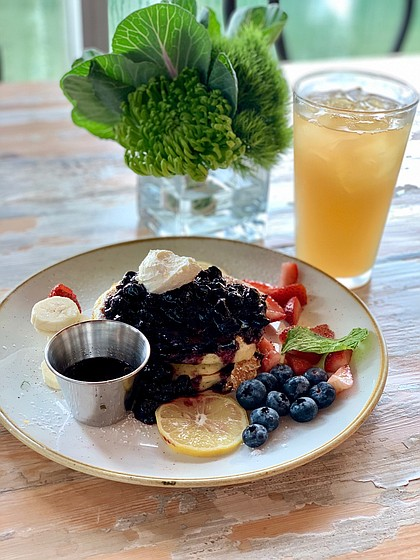 ricotta pancakes topped with blueberries and strawberries at The Dunlavy