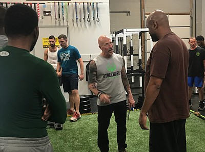 Timothy Guinan (middle) is the owner, trainer and coach of the Otherworld Fitness in Frederick, Md. He opened his gym to assist others dealing with addiction in hopes that exercise will help them with the healing process.