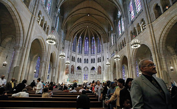 Members of the congregation file out after Sunday morning worship services at Riverside Church in New York on July 20, 2014. The building is modeled after a 13th century cathedral in Chartres, France.