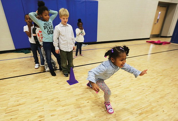 Alani Mason, 6, takes off in a sprint to the finish line during a game Tuesday at the Northside Family YMCA on Old Brook Road. The youngster and her friends in the YMCA after-school program were ready to burn some energy after returning to school this week at the start of a new decade.