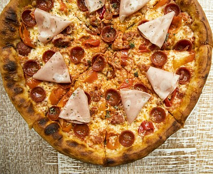 meat lovers pizza at the C. Baldwin Lobby Bar