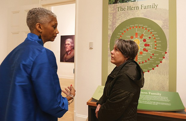 Black History Museum Executive Director Adele Johnson left, talks with Karen Schwarzkopf of Richmond Family magazine about the exhibit on the enslaved at Monticello that will run Jan. 18 through April 18 at the museum.