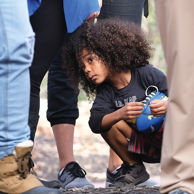 Young advocate  Major West, 5, listens as speakers read letters from inmates and urge changes in the state's laws and criminal justice system during last Saturday's Virginia Prison Reform rally in Capitol Square. The youngster accompanied his family to the rally.