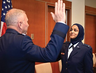 U.S. Air Force Chaplain Candidate Saleha Jabeen, right, is commissioned last month by Maj. Gen. Steven Schaick U.S. Air Force chief of chaplains at the Catholic Theological Union in Chicago.
